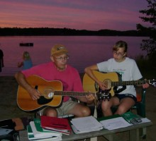 Music at sunset on Boulder Lake - Knotty Pines Resort